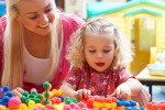 AU Pair playing with girl